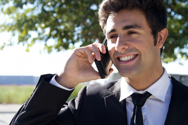 portrait of young businessman talking with smartphone 1301 7020